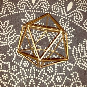 Geometric gold house decor piece